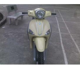 Cần bán Piaggio Libetty 125cc nhập Italia màu kem thời trang cho anh em đi tết.biển 30K7.có ảnh xe