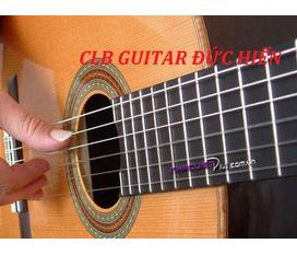 Dạy và tặng đàn guitar