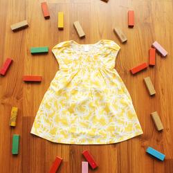 Ảnh số 86: Áo váy trắng bướm vàng - Giá: 1.000