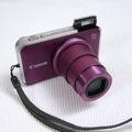Bán Canon SX210is máy màu tím hồng, SX210 bản nâng cấp của sx200, độ phân giải 14.1mp, zoom quang 14x