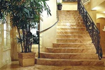 cầu thang đá vàng marble vân rồng